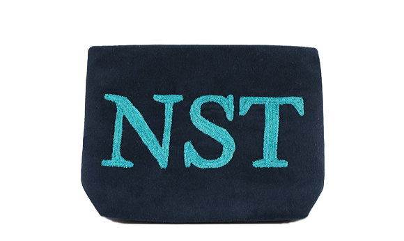 Ultra suede clutch with embroidered monogram